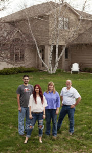 The Schoenherr family in front of their Woodbury home.